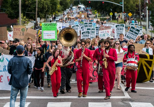 More than one thousand people march down Main Street in Burlington from the University of Vermont on Friday, Sept. 20, 2019, where they joined with more than a thousand more for the Vermont Climate Strike Rally, part of the Global Climate Strike worldwide to draw attention to climate change.