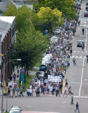 Vermont Climate Strike demonstrators march up Pine Street in Burlington and turn onto Main Street to meet other demonstrators at City Hall on Friday, Sept. 20, 2019.
