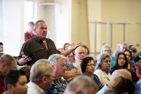 Tony Ramon, who lives near the 19 crude oil storage tanks being constructed near Calallen by EPIC Crude Holdings, questions EPIC CEO Phil Mezey during a town hall on Thursday, Sept. 19, 2019.