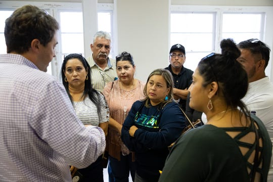 Residents affected by Epic's 19 crude oil storage tanks being constructed near Calallen talk to a representatives of Epic during a town hall meeting on Thursday, Sept. 19, 2109.
