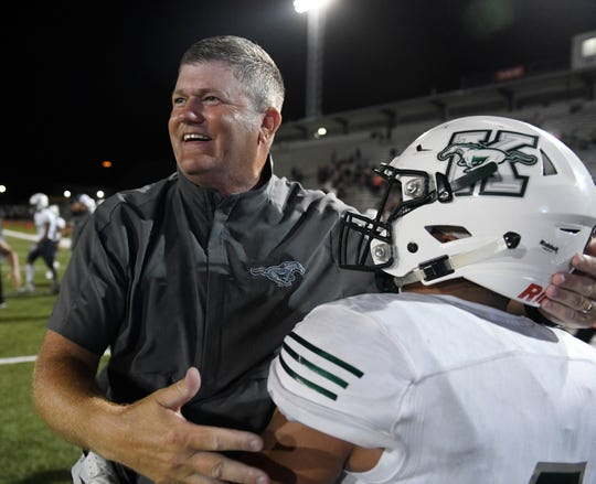King's head coach Eddie Hesseltine celebrates the season's first win against Ray, Thursday, Sept. 19, 2019, at Buc Stadium. The final score was 28-21.