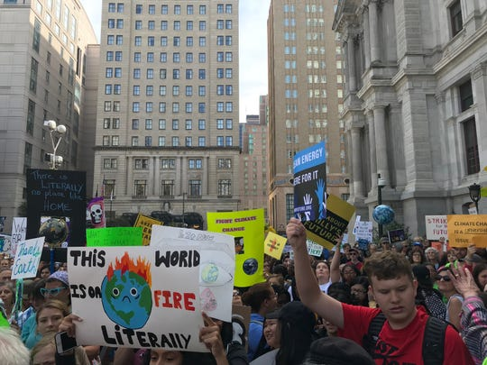 Students filled the streets around Philadelphia City Hall Friday to protest inaction on climate change.