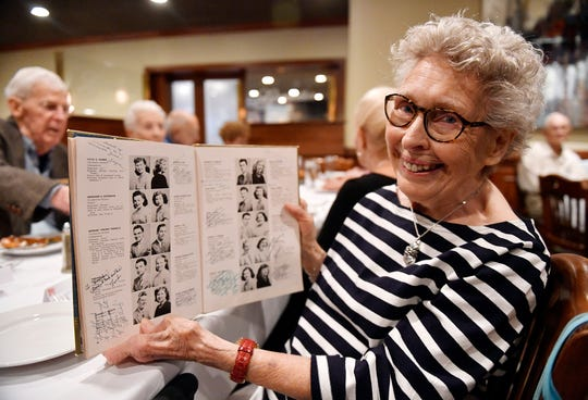 Collingswood High School Class of 1949 graduate Shirley Hough holds a year book during her 70th class reunion at Giumarello's Restaurant in Westmont.