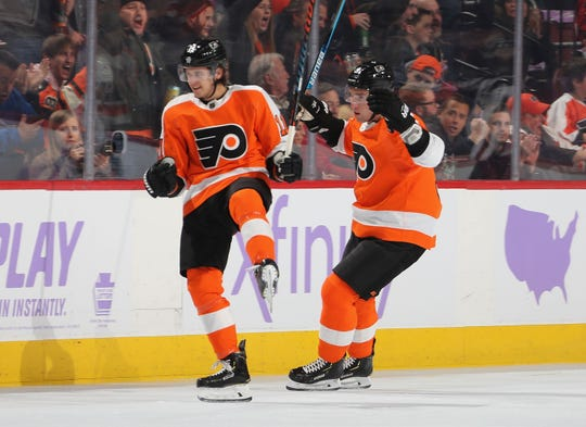 Travis Konecny (left) and Ivan Provorov each signed six-year deals to stay with the Flyers after a long summer of negotiations.