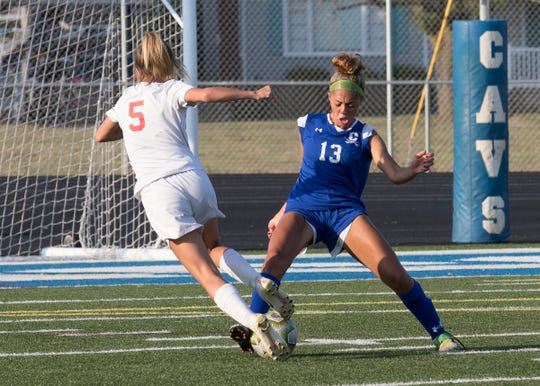 Chillicothe's Allia Hoosier takes possession of the ball from Hillsboro's Bryanna Bledsoe Thursday night at Chillicothe High School. The Cavaliers would defeat the Indians 2-0.