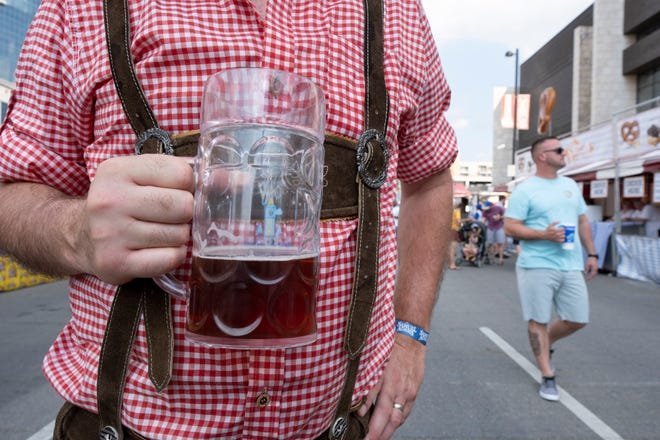 Joe Wood holds his beer stein at the opening day of Oktoberfest Zinzinnati in downtown Cincinnati, Ohio on Friday, Sept. 20, 2019.
