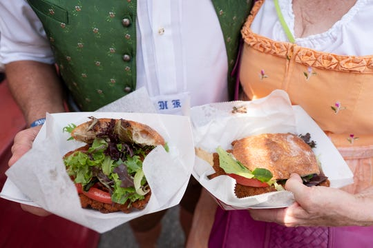 Pork schnitzel sandwich from The Lubecker is photographed with Helmut and Connie Keintz at the opening day of Oktoberfest Zinzinnati in downtown Cincinnati, Ohio on Friday, Sept. 20, 2019.