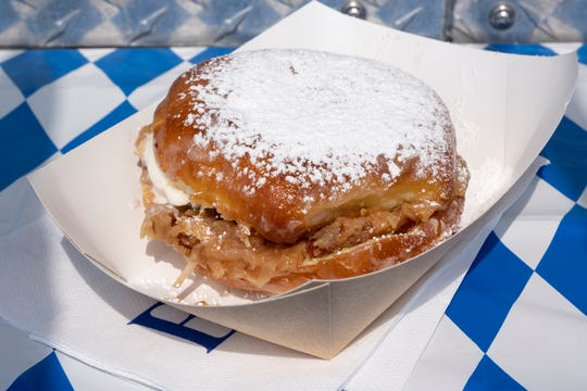The bienenstitch Halo doughnut from Busken's Halo Doughnut Truck is photographed at the opening day of Oktoberfest Zinzinnati in downtown Cincinnati, Ohio on Friday, Sept. 20, 2019.