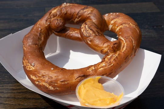 Pretzel with horseradish cheese from The Lubecker is photographed at the opening day of Oktoberfest Zinzinnati in downtown Cincinnati, Ohio on Friday, Sept. 20, 2019.