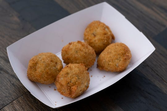 Photographed are goetta sauerkraut balls from Hey Hey at the opening day of Oktoberfest Zinzinnati in downtown Cincinnati, Ohio on Friday, Sept. 20, 2019.