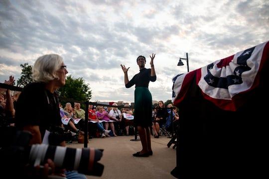Sign language interpreter Epiphany Davis translates U.S. Sen. Elizabeth Warren's, D-Mass., rally outside the Iowa Memorial Union on Thursday, Sept. 19, 2019 on the University of Iowa campus in Iowa City.