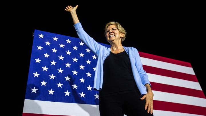 Democratic presidential candidate U.S. Sen. Elizabeth Warren, D-Mass., waves to supporters after speaking during a campaign event, Thursday, Sept., 19, 2019, along the Iowa River behind the Iowa Memorial Union at an amphitheater on the University of Iowa campus in Iowa City, Iowa.