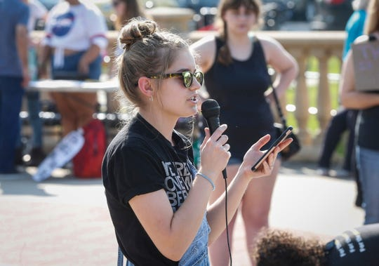 Isabella Cook of West Des Moines speaks to hundreds on Friday, Sept. 20, 2019, on the capitol grounds in Des Moines during the climate strike event, one of more than 150 similar strikes nationwide.