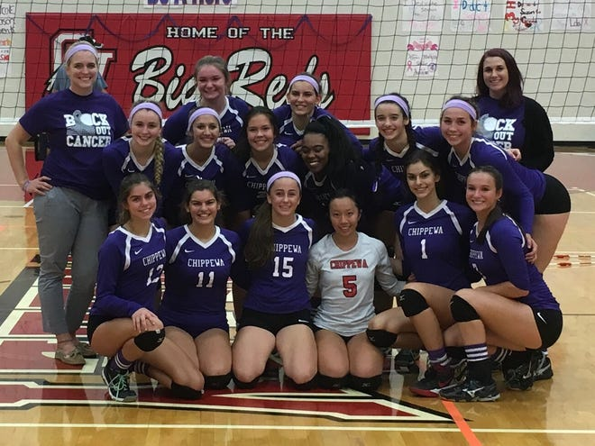 Nichole Wouters, left, poses for a picture with the Clinton Twp. Chippewa Valley volleyball team in 2017 during the team's caner awareness night.