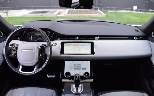 Range Rover Evoque's top screen is the vehicle's main portal while the bottom screen includes HVAC controls.