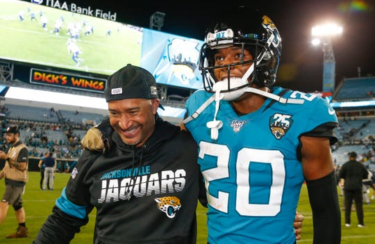 Jags cornerback Jalen Ramsey and cornerback coach Tim Walton smile after the win over the Titans on Thursday.
