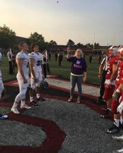 Nichole Wouters flips the coin before a Clinton Twp. Chippewa Valley football home game in 2017.