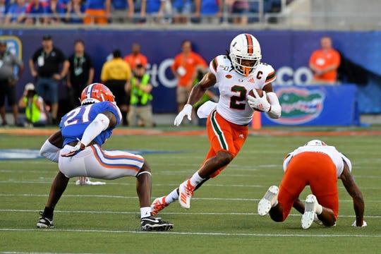 Miami receiver K.J. Osborn runs against Florida at Camping World Stadium, Aug. 24, 2019 in Orlando.