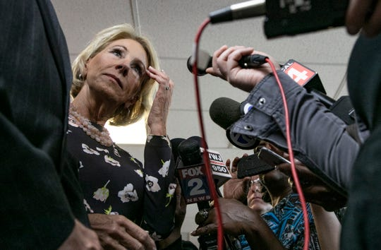 United States Secretary of Education Betsy DeVos answers some questions from the media as she tours Detroit Edison Public School Academy in Detroit Friday, Sept. 20, 2019.