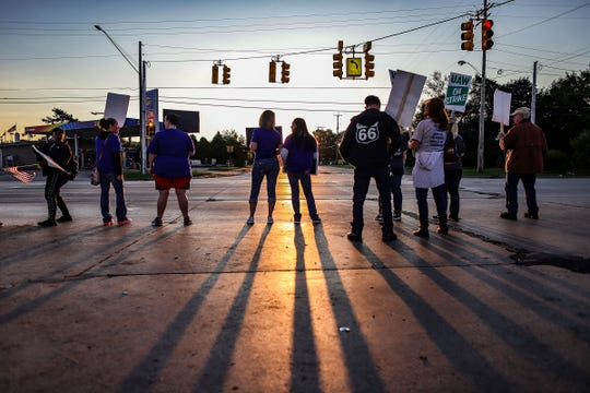 UAW General Motor workers block one of the entrances at General Motors Flint Assemby plant on the fourth day of the nationwide UAW strike after stalled contract talks with GM in Flint, Mich. on Thursday, Sept. 19, 2019.