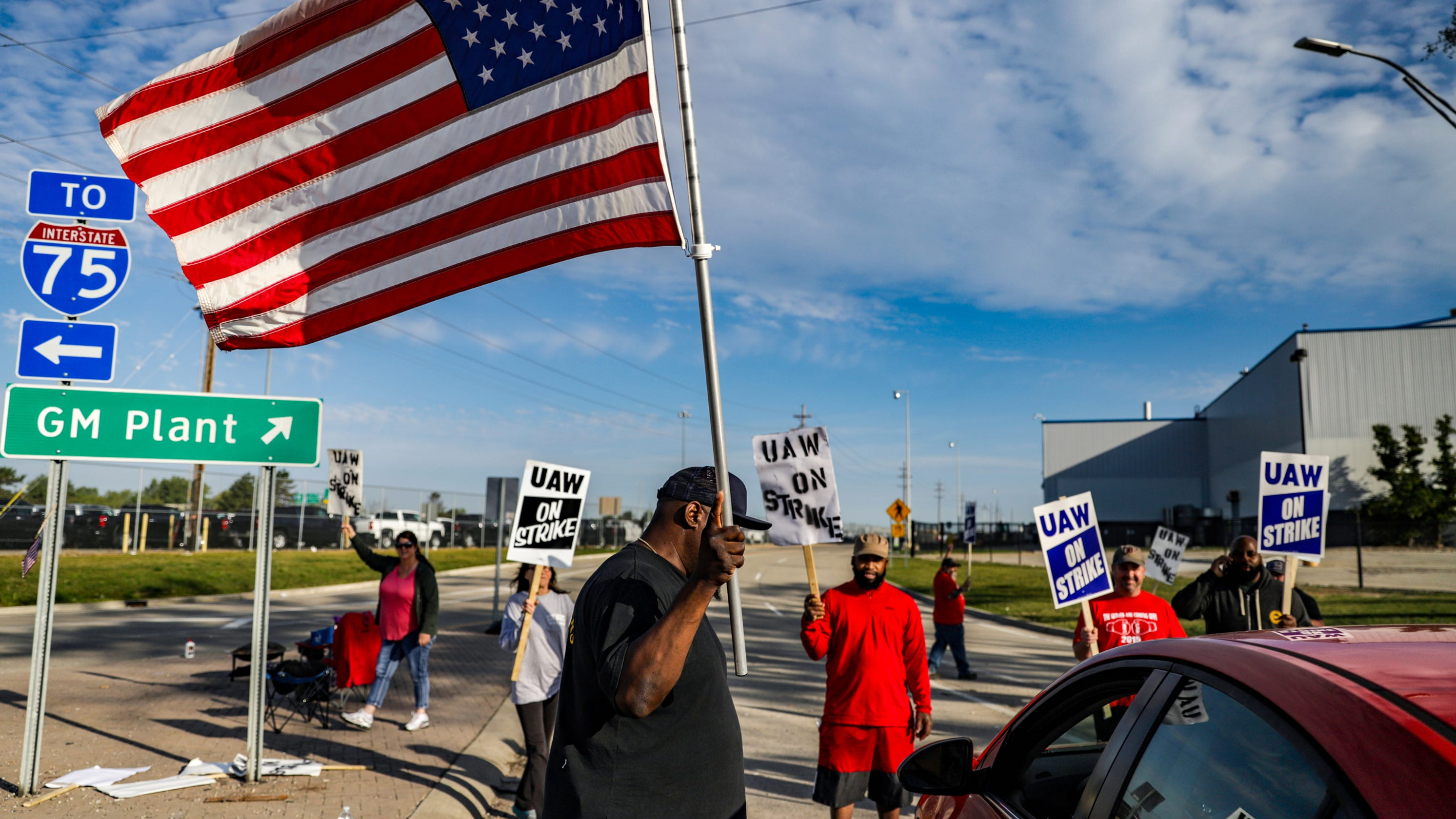 A week in, these GM strikers are worried but determined: 'This is America'