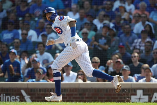 Chicago Cubs right fielder Nicholas Castellanos hits a double against the Pittsburgh Pirates in the first inning Sept. 15, 2019 at Wrigley Field in Chicago.