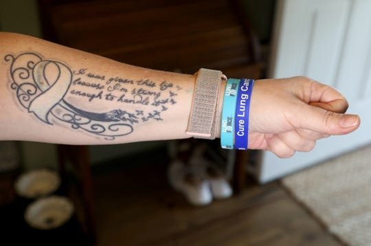 """Debbie Pickworth of Garden City, who has stage IV lung cancer, shows off the tattoo in her home on Friday, August 30, 2019. It says, """"I was given this life because I'm strong enough to handle it."""" Pickworth's grandmother and mom both died from lung cancer and she's gone through several medical trials. Her cancer has been stable since 2014."""