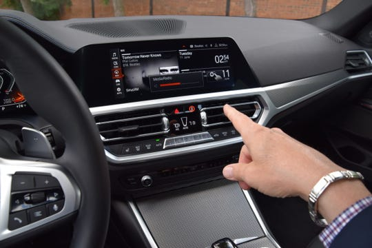 BMW 330i's  gesture control feature allows a driver to adjust volume without touching anything and instead by pointing, sweeping your hand or making circular motions with your finger.