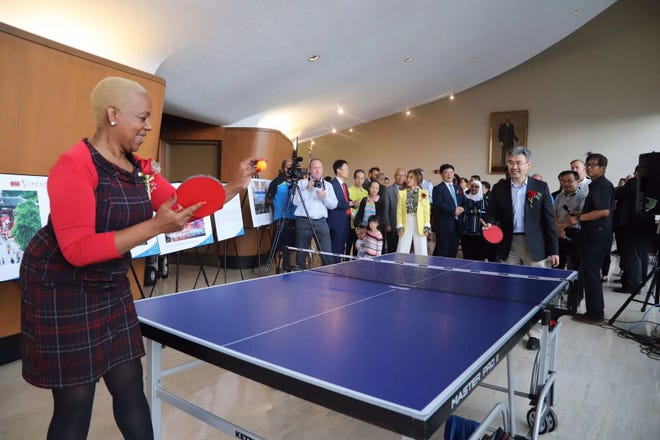 Michigan state  Rep. Cynthia Johnson and Chinese Consul General Zhao Jian play table tennis Sept. 13 at the Coleman A. Young Municipal Building as part of Detroit China Day Event held to commemorate the 40th anniversary of diplomatic relations between China and the United States.