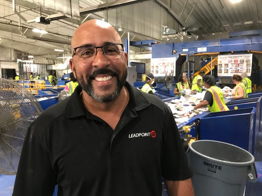 Onsite Manager Doug Birch, who supervises labor at a recycling plant in Oakland County, stands before a team of sorters removing contamination on Sept. 19, 2019.
