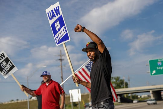 Keondris Howell, 40, of Flint is a temporary worker striking outside of the General Motors Flint Assembly Plant on the fourth day of the UAW nationwide strike  after stalled contract talks with General Motors in Flint, Mich. on Thursday, Sept. 19, 2019. Howell has been a temp for four years and says he is number two in line to be hired full time.
