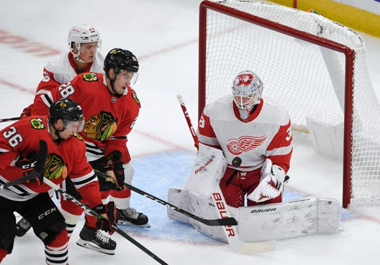 Detroit Red Wings goalie Filip Larsson makes a save against the Chicago Blackhawks during the preseason game Wednesday, Sept. 18, 2019, in Chicago.