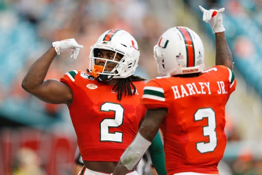 Miami receiver K.J. Osborn celebrates (2) after a touchdown against Bethune Cookman on Sept. 14, 2019 in Miami.