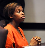 In this March 25, 2014, file photo, Ebony Wilkerson listens during a bond hearing in Daytona Beach, Fla.