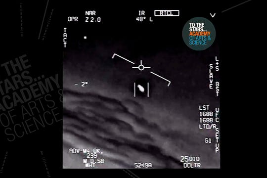 In this undated image made from video from a U.S. Navy aircraft and released by The Stars Academy of Arts & Science, an unidentified object moves near the plane in the air.