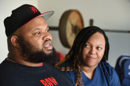 Antonio Martin, wounded in a Detroit shooting, is ranked 6th in the world as a power lifter. He talks to a reporter while sitting with his wife Melanie at their home in  Utica on Wednesday. Martin, is set to qualify on the U.S. Paralympic Team for the Tokyo 2020 Summer Games.
