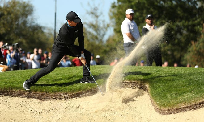 Rory McIlroy plays out of a bunker during the PGA Championship at Wentworth Golf Club on Thursday.