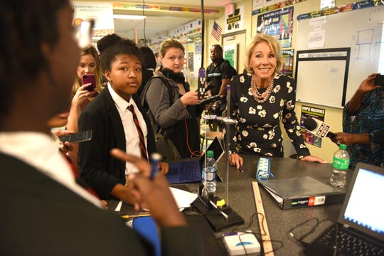 U.S. Education Secretary Betsy DeVos recently visited Detroit Edison Public School Academy, a charter that will be impacted by Gov. Gretchen Whitmer's budget cuts.
