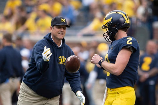 Michigan coach Jim Harbaugh and quarterback Shea Patterson will look to make a statement at Wisconsin on Saturday.