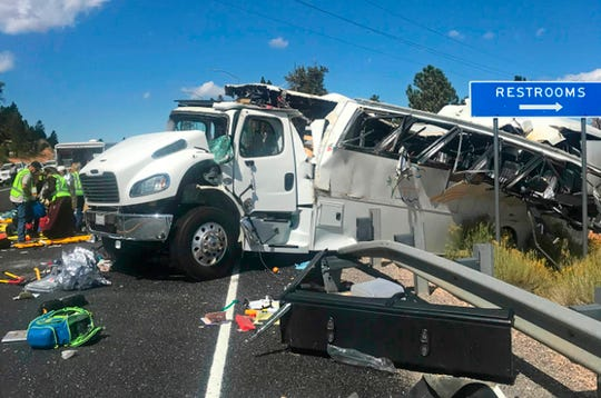 A tour bus that was carrying Chinese-speaking tourists after it crashed near Bryce Canyon National Park in southern Utah, killing at least four people and critically injuring up to 15 others, Friday, Sept. 20, 2019.