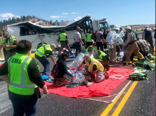 Emergency Medical Services personnel assist victims of a bus crash near Bryce Canyon National Park in southern Utah.