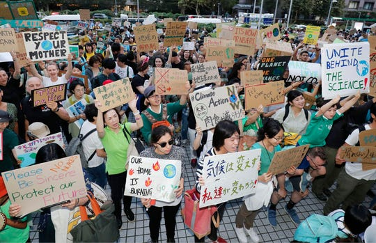 People participate in a rally against climate change in Tokyo Friday, Sept. 20, 2019.