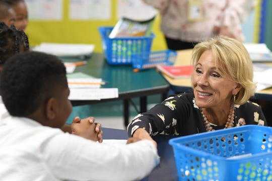 U.S. Secretary of Education Betsy DeVos greets 3th grade students during a visit to Detroit Edison Public School Academy (DEPSA) on Friday, Sep. 20, 2019, as part of her Back To School Tour.
