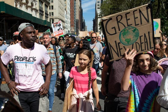Swedish environmental activist Greta Thunberg, center, takes part during the Climate Strike, Friday, Sept. 20, 2019 in New York.