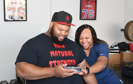Antonio Martin, wounded in a Detroit shooting, is ranked 6th in the world as a power lifter. He shares a moment with his wife Melanie at their home in Utica.