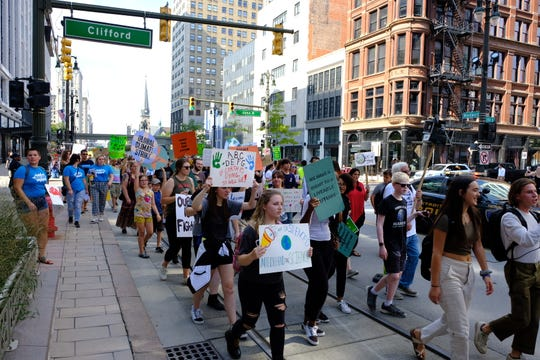 "Hundreds of protesters took to the street Friday, blocking off traffic on Woodward as they marched from Grand Circus Park to Hart Plaza as a part of a Global Climate Strike. Youth led the march calling for immediate action to ""save their future."""