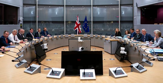 Britain's Brexit Secretary Stephen Barclay, second left, sits along with his team during a meeting with European Union chief Brexit negotiator Michel Barnier, second right, at the European Commission headquarters in Brussels, Friday, Sept. 20, 2019.
