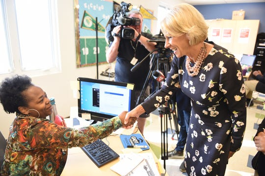 U.S. Secretary of Education Betsy DeVos greets counselor Ebony Porter during her visit to Detroit Edison Public School Academy (DEPSA) on Friday.