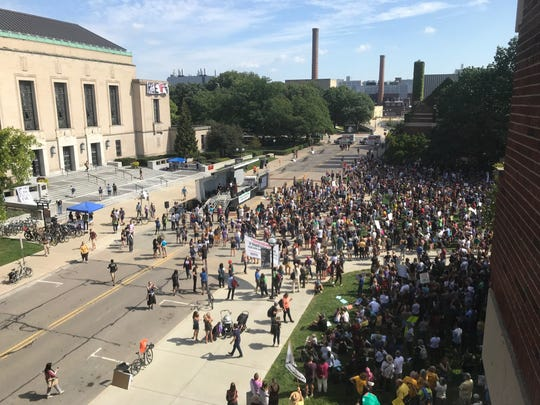 Climate change protesters rally on the University of Michigan's campus on Friday, Sept. 20.