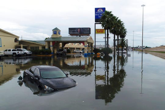 Several cars were flooded along Interstate 10 in Southeast Texas, Thursday, Sept. 19, 2019, due to Tropical Storm Imelda.